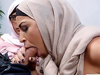 Two Middle Eastern women shared a lucky hard cock on the couch
