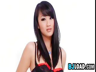 Cute Asian babe is willing to ride a huge dong